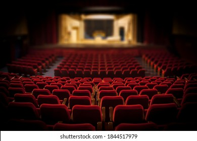 Empty red armchairs of a theater ready for a show