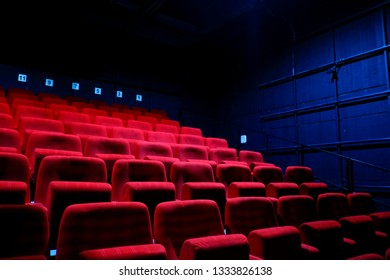 Empty red chairs in theatre.
