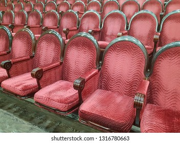 Empty red cinema hall seats, chairs. Perspective view