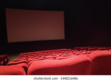 empty red cinema seats taken from mid rows