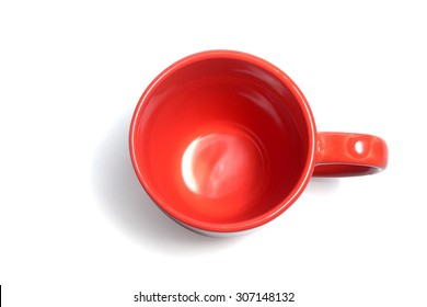 empty red color coffee cup on white top view