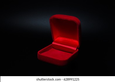 Empty red gift box on a black  background
