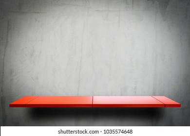Empty Red metal display shelf on grungy cement wall