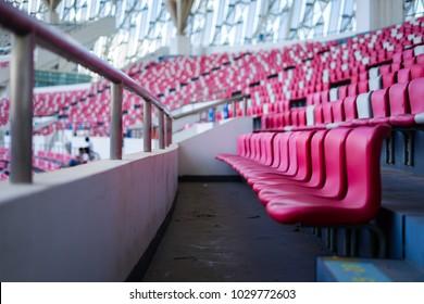 Empty red seats in sport stadium