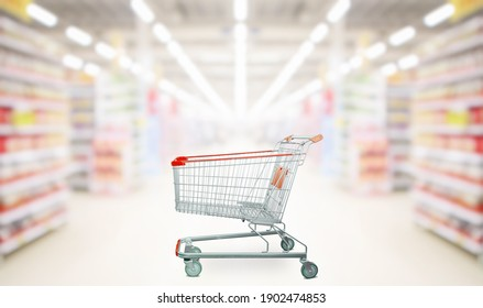 empty red shopping cart in supermarket