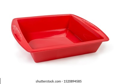 Empty red square silicone baking tray with rim on a white background