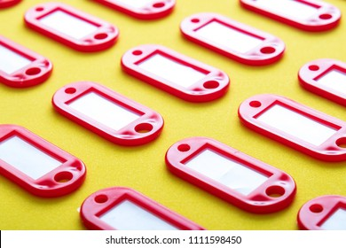 empty red tags without the inscriptions of the keys, many identical key fobs for indicating the key from the side view