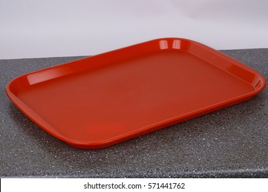 Empty red tray. Copy space.