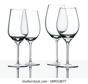 Empty red and white wine glasses isolated on white with reflection.