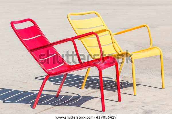 Terrific Empty Red Yellow Metal Outdoor Chairs Stock Photo Edit Now Machost Co Dining Chair Design Ideas Machostcouk