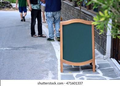 Empty restaurant blackboard on street