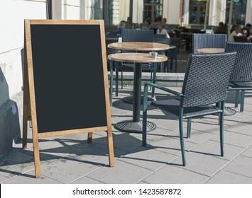 Empty restaurant menu blackboard on the street, menu chalkboard mockup, menu board template