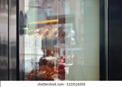 Empty restaurant window from outside for logo design promotion, mockup.