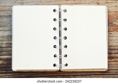 An empty retro spiral notebook with old paper