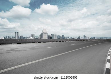 empty road with city skyline