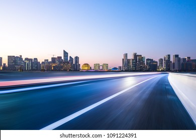 empty road with city skyline in hangzhou china