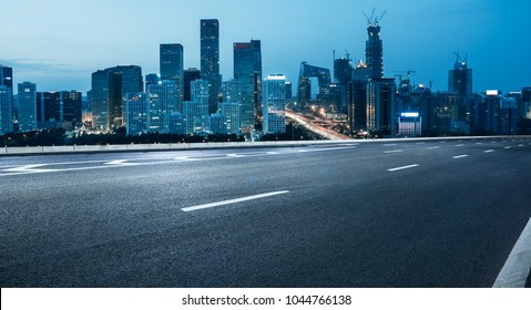 empty road with city skyline,beijing,china.