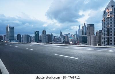 empty road with city skyline,shanghai,china.