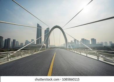empty road with cityscape in modern city, in nanjing,china