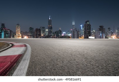 empty road with cityscape of shanghai modern buildings background at night