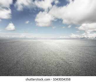 empty road with cloudy sky background