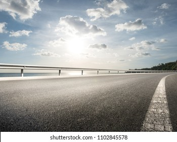 Empty road with coastline background