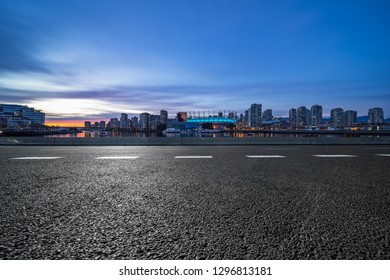 empty road with downtown background, vancouver,canada.