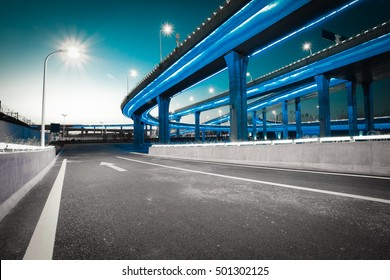 Empty road floor with city elevated bridge of night scene