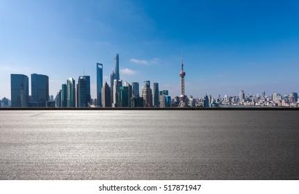 Empty road floor surface with modern city landmark buildings in Shanghai skyline of panorama