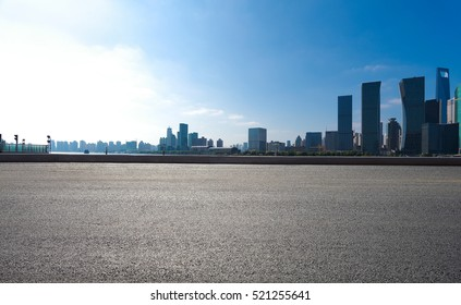 Empty road floor surface with modern city landmark buildings of Shanghai bund Skyline