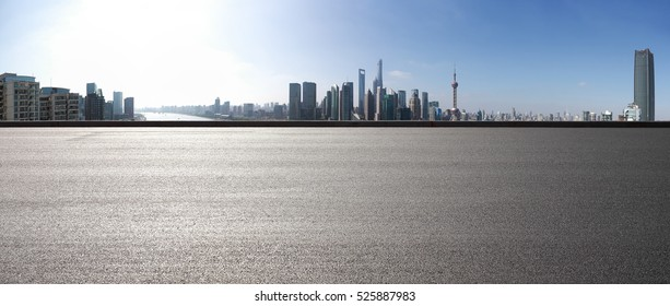 Empty road floor surface with modern city landmark buildings in Shanghai skyline of 180 degrees panorama