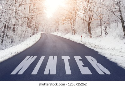 Empty road in forest in winter with winter text
