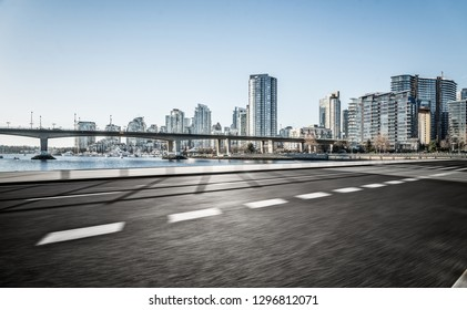 empty road go through downtown vancouver,canada.