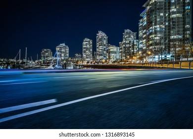 empty road go through harbor at night.