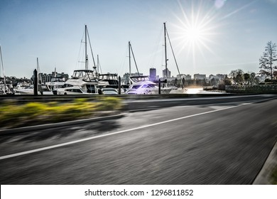 empty road with harbor backgound, vancouver canada.