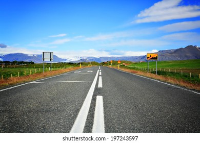 Empty road in Iceland on a sunny summer day