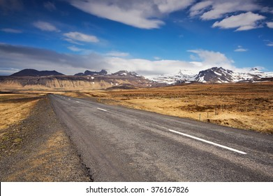 Empty road in Iceland on a sunny summer day.