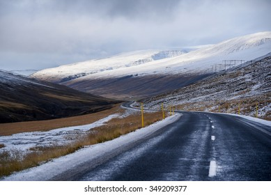 Empty road leading to snow covered mountains, Beautiful landscape in early winter of Iceland