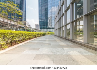 Empty road and modern business buildings