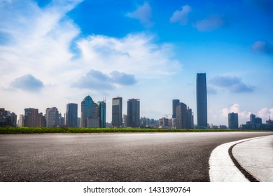 empty road with modern highrise in city,shanghai,China.