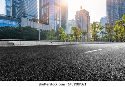 empty road with modern highrise in city,shenzhen,China.