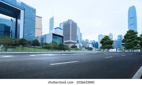 empty road and modern office block buildings against sky,Hong Kong,China.