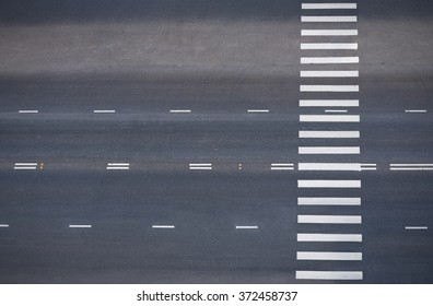 empty road with pedestrian crossing, top view