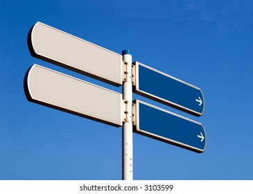 Empty road sign, two directions, isolated against a clear blue sky