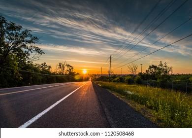 Empty road at sunrise