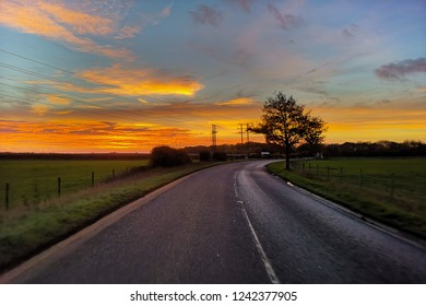 Empty road with sunrise