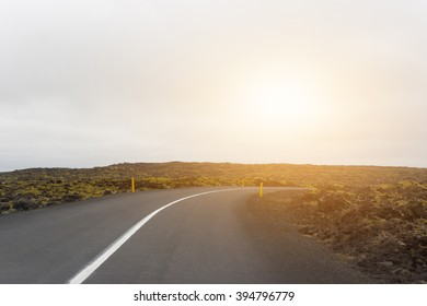 Empty road in sunset