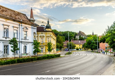 Empty road in the sunset in a historic part of a city. Miskolc, Hungary