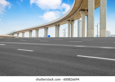 Empty road surface floor with city overpass viaduct bridge in shanghai