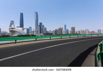 Empty road surface floor with modern city landmark architecture backgrounds in Guangzhou Skyline
